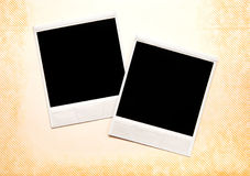 Instant images. Two instant photographs on an old photo album page Stock Photography