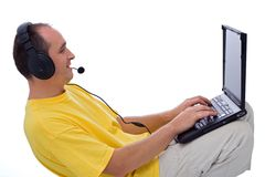 Instant messaging. Man with laptop, instant messaging: on-line chat and talking with friends Royalty Free Stock Photo