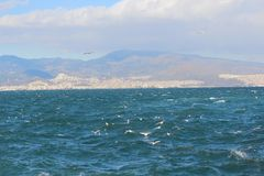 Instant moment shot of sea view from across the gulf. In Turkey Royalty Free Stock Photos