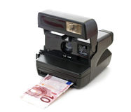 Instant money. Instant camera developes money, euros, isolated on white background Royalty Free Stock Photos
