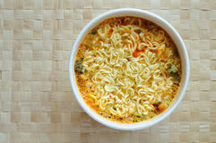 Instant noodle. Spicy instant noodle in a foam bowl Stock Photography