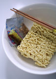 Instant Noodle. Uncooked instant noodle with ingredients in a bowl Royalty Free Stock Photo
