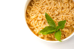 Instant noodle with basil leaf. Stock Images