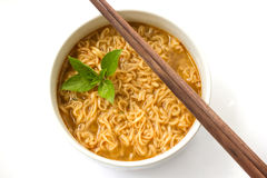 Instant noodle with basil leaf. Stock Photos