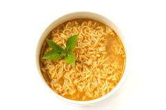 Instant noodle with basil leaf. Royalty Free Stock Photo