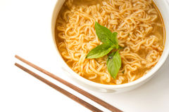 Instant noodle with basil leaf. Royalty Free Stock Image