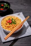 Instant noodle in bowl cooked spicy taste topping.  royalty free stock photo