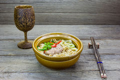 Instant noodle in a bowl on a wooden background Stock Images
