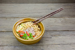 Instant noodle in a bowl on a wooden background Stock Photography
