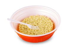 Instant noodle in cup with plastic fork on white background. Royalty Free Stock Photos