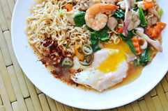 Instant noodle dressing seafood gravy sauce and creamy egg yolk on plate Stock Photography
