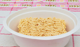 Instant noodle. Dry instant noodle in a bowl Royalty Free Stock Photography