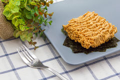 Instant noodle and Fried seaweed Stock Photography