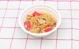Instant noodle. Hot and spicy instant noodle with pork and surimi Stock Images