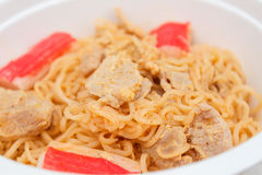 Instant noodle. Hot and spicy instant noodle with pork and  surimi Royalty Free Stock Photos