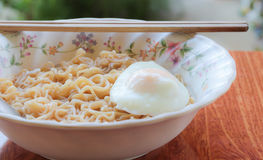 Instant noodle. S in bowl with eggs Royalty Free Stock Photo