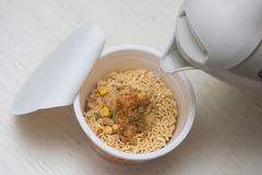 Instant noodle quickly cooking for eat Stock Images
