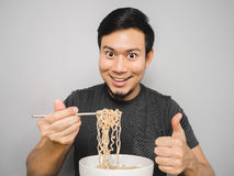 Instant noodle surprisingly delicious. Asian man feel surprise with how delicious instant noodle is Royalty Free Stock Images