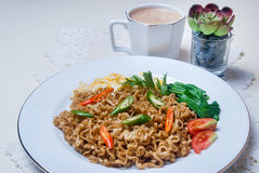 Instant noodles with Asian tastes there are eggs and drinks Royalty Free Stock Photo