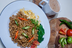 Instant noodles with Asian tastes there are eggs and drinks Royalty Free Stock Image