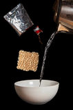 Instant noodles. Boil the noodles bears in three minutes Stock Image