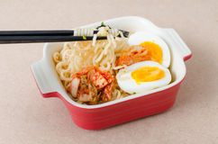 Instant noodles with boiled egg and kimchi Stock Images
