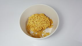 Instant noodles in a bowl on a white background Royalty Free Stock Images
