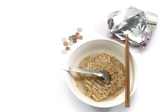 Instant noodles with chopsticks , spoon and some coins. Isolated in white background. Concept when you no money. Last supper, cheap food stock photos