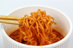 Instant noodles in the cup with chopsticks Stock Photo