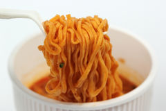 Instant noodles in the cup with plastic fork Royalty Free Stock Images
