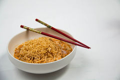 Instant noodles in dish on white Royalty Free Stock Photos