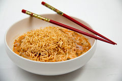 Instant noodles in dish on white Royalty Free Stock Photography