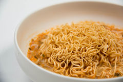 Instant noodles in dish on white Royalty Free Stock Images