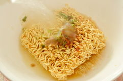 Instant noodles dressing seasoning powder pouring hot water for soft boiled. On bowl Royalty Free Stock Images