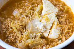 Instant noodles. With egg in a bowl Royalty Free Stock Images