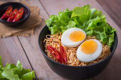 Instant noodles with egg in bowl Stock Image