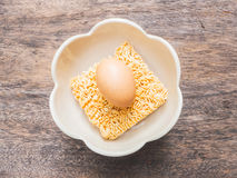 Instant noodles and egg in bowl Stock Photography