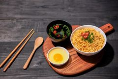 Instant noodles with egg in wooden bowls.  Royalty Free Stock Photography