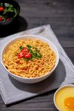 Instant noodles with egg in wooden bowls.  Stock Photo