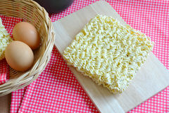 Instant noodles and eggs on table. Royalty Free Stock Photos