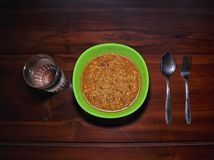 Instant noodles isolated on wooden background royalty free stock image