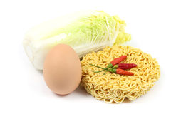 Instant noodles with ingredient. On white background Stock Photography