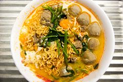 Instant noodles with meat and Meatballs royalty free stock photography