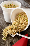 Instant noodles pasta ramen spilled on rustic wood table Stock Photos