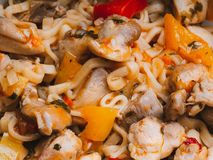 Instant noodles or pasta with vegetables and chicken meat with sauce. Traditional Asian food close-up. Instant noodles or pasta with vegetables and chicken meat stock photography