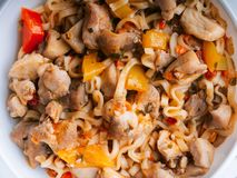 Instant noodles or pasta with vegetables and chicken meat with sauce. Traditional Asian food close-up. Instant noodles or pasta with vegetables and chicken meat stock image
