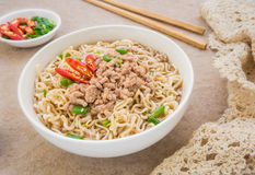 Instant noodles with pork in bowl Stock Image