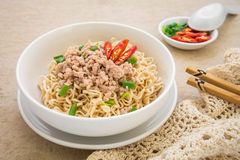 Instant noodles with pork in bowl Stock Photography