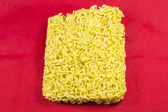 Instant noodles. On a red background Royalty Free Stock Photography