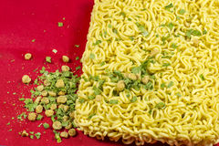 Instant noodles. On a red background Royalty Free Stock Images